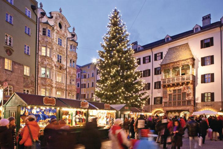 "Christkindlmarkt in Innsbruck – the famous Golden Roof (German: ""Goldene Dachl"") is in the background."