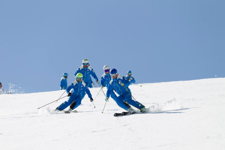 Riding in formation helps train controlled, cautious skiing.