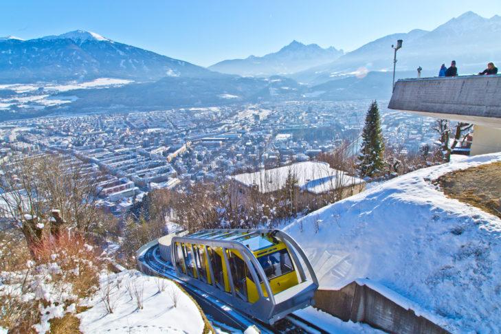 Nordkettenbahn above a panoramic view of Innsbruck.