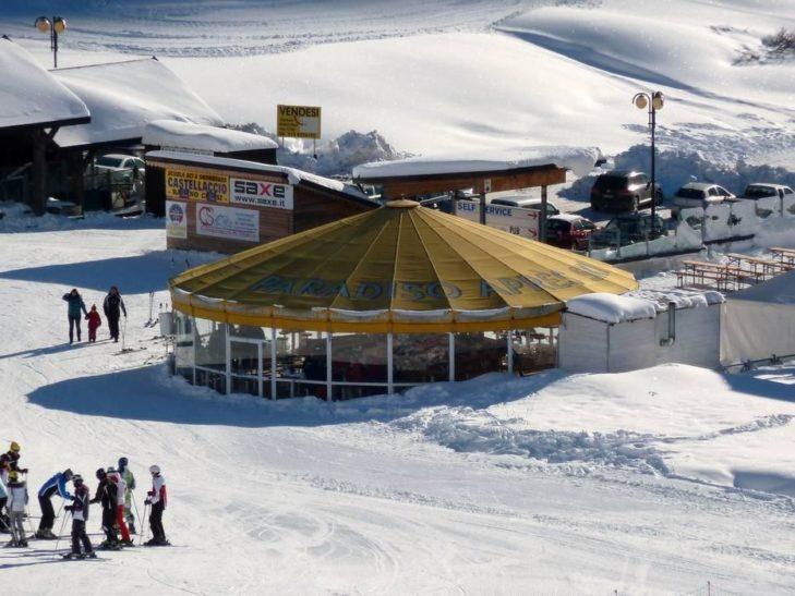 The Adamello ski area's umbrella bars and après ski scene invites holidaymakers to unwind.