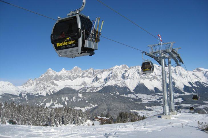 Modern gondolas travel up the Reiteralm in the Schladming-Dachstein ski area.