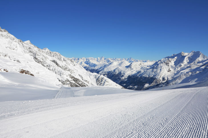 Perfectly groomed piste in the Saas-Fee ski area.