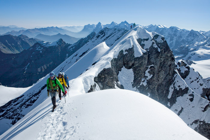 A mountain tour on the summit with views of the Eiger, Mönch and Jungfrau.