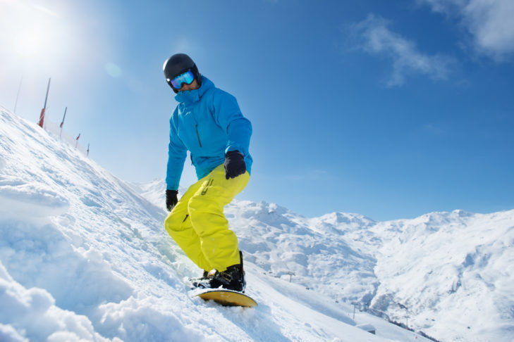 Snowboarder starting on a slope.